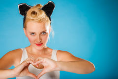 Pin up style, retro girl with heart sign. royalty free stock images