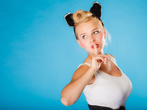 Pin up style, retro girl with silence sign. Stock Photography