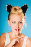 Pin up style, retro girl with silence sign. Royalty Free Stock Photos