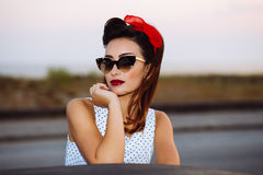 Pin-up with sunglasses Royalty Free Stock Image