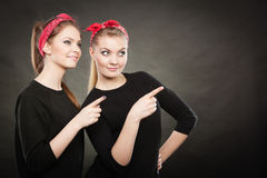 Pin up vintage ladys showing one direction. Stock Photos