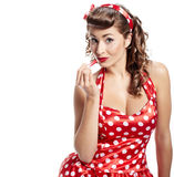 Pin-up  woman. Applying her make-up Royalty Free Stock Images
