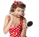 Pin-up  woman. Applying her make-up Stock Photo