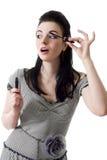 Pin-up woman applying mascara isolated royalty free stock photos