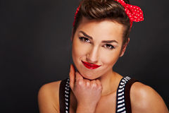 Pin-up woman with big smile on black background Stock Photography
