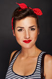 Pin-up woman with big smile on black background Royalty Free Stock Image