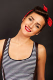Pin-up woman with big smile on black background Stock Images