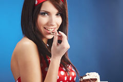 Pin-up woman with the cake Royalty Free Stock Image