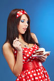 Pin-up woman with the cake Royalty Free Stock Photos