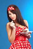 Pin-up woman with the cake Stock Photos