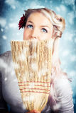 Pin-up Woman Cleaning Up In Cold Blue Winter Snow Royalty Free Stock Images