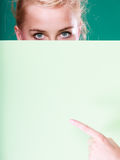 Pin up woman eyes behind white sign Royalty Free Stock Images