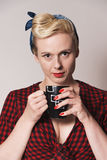 Pin up woman holding a mug Stock Image