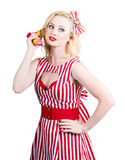 Pin up woman ordering organic food on banana phone Stock Images