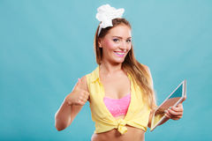 Pin up woman with pc tablet giving thumb up sign. Royalty Free Stock Photos