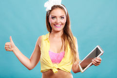 Pin up woman with pc tablet giving thumb up sign. Stock Image