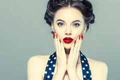 Pin up woman portrait. Beautiful retro female in polka dot dress with red lips. Studio shot royalty free stock photo