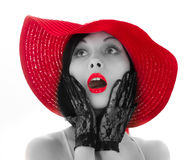 Pin-up woman with red hat and lips Stock Image