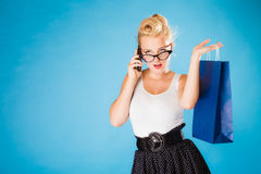 Pin up woman with shopping bag and phone. Stock Photos