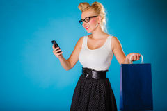 Pin up woman with shopping bag and phone. Stock Image
