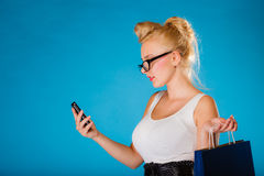 Pin up woman with shopping bag and phone. Royalty Free Stock Photos