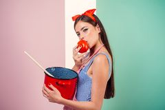 Pin up woman with trendy makeup. pinup girl with fashion hair. retro woman cooking in kitchen. perfect housewife. pretty. Girl in vintage style. Only healthy royalty free stock photos