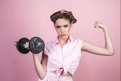 Pin up woman with trendy makeup. retro woman with dumbbell. Sport. pinup girl with fashion hair. pretty girl in vintage. Style. powerful housewife. Exercising stock images