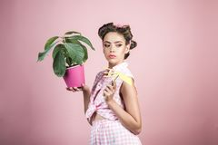 Pin up woman with trendy makeup. retro woman growing plants. Garden. pinup girl with fashion hair. spring. pretty girl. In vintage style. greenhouse worker or stock image