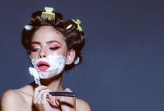 Pin up woman with trendy makeup. retro woman shaving with foam and razor blade. pinup girl with fashion hair. pretty. Girl in vintage style. morning grooming stock images