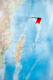 Pin on the world map. Red pin on the world map Royalty Free Stock Photography