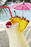 Pina colada. Tropical drink at sandy beach on the ocean stock photography