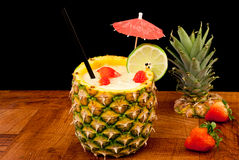 Pina colada. Fresh tropical pina colada cocktail served in a pineapple stock photography
