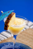 Pina Colada. A pineapple pina colada smothie isolated over blue Royalty Free Stock Photos