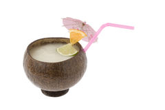Pina Colada Cocktail. Pina Colada mixed drink with fruit garnish in a cocoanut container on white background Stock Photos