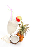 Pina Colada cocktail. Delicious cocktail pina colada with coconut and pineapple on white background. Cool summer drinks Stock Photo