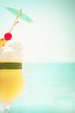Pina colada cocktail with fruits and umbrella decoration Stock Image
