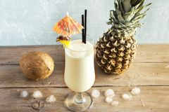 Pina Colada Cocktail. With pineapple and coconut over wooden background, copy space. Summer tropical delicious cocktail stock photos