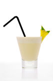Pina Colada Cocktail (side view). A glass of Pina Colada Cocktail with a straw and a piece of pineapple royalty free stock image