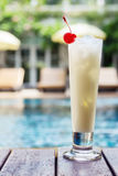 Pina colada cocktail beside swimming pool Royalty Free Stock Photography
