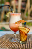 Pina colada cocktail on tropical background Royalty Free Stock Image