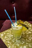 Pina Colada Cocktail with two blue straws and pineapple Stock Images