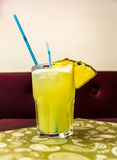 Pina Colada Cocktail with two blue straws and pineapple Royalty Free Stock Image