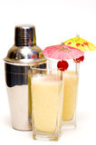 Pina colada cocktail with umbrella & shaker. Isolated on white background royalty free stock images