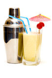 Pina colada cocktail with umbrella & shaker Royalty Free Stock Photos