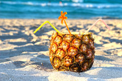 Pina Colada drink. In fresh pineapple on the beach Royalty Free Stock Image