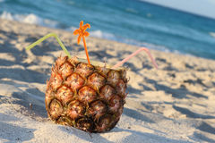 Pina Colada drink. In fresh pineapple on the beach Royalty Free Stock Photography