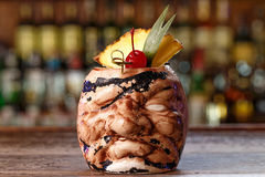 Pina colada with pineapple. A traditional Caribbean alcoholic cocktail based on light rum, with coconut milk and pineapple juice on a bar counter background Royalty Free Stock Images