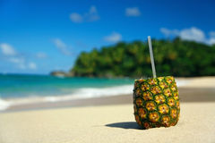 Pina colada with pipe on beach Royalty Free Stock Photo