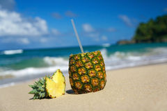 Pina colada with pipe on beach of Atlantic ocean Royalty Free Stock Photo