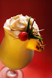 Pina Colada on red. Pina Colada - Cocktail with Cream, Pineapple Juice and Rum over red backround stock photography